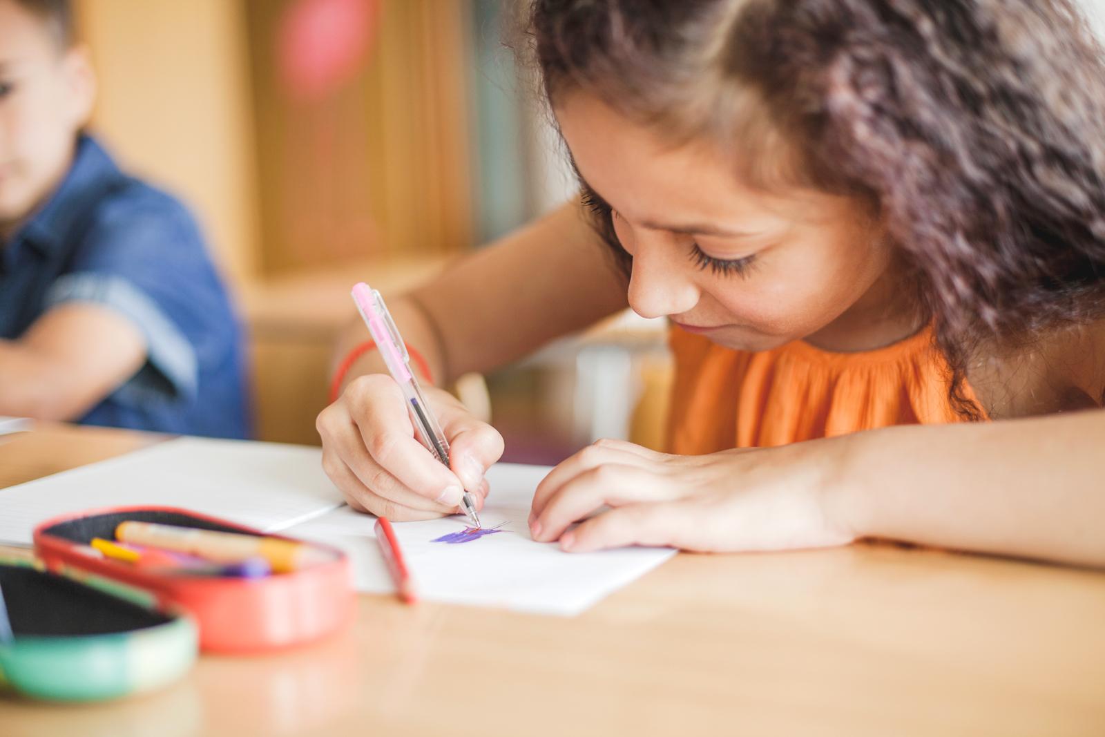 schoolgirl-sitting-table-drawing